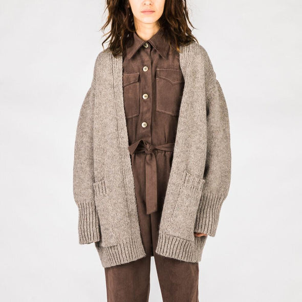 Light brown cardigan with slumped shoulders and two front pockets.