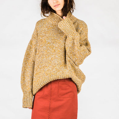 Yellow turtleneck sweater made from recycled fibers.