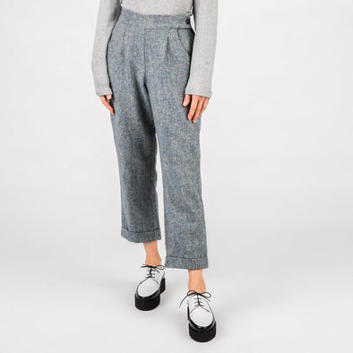 Blue medium waist wool trousers with hidden side pockets.