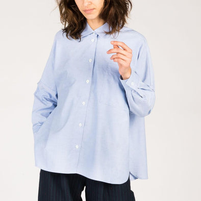 Loose-fitting long sleeve shirt in light blue.