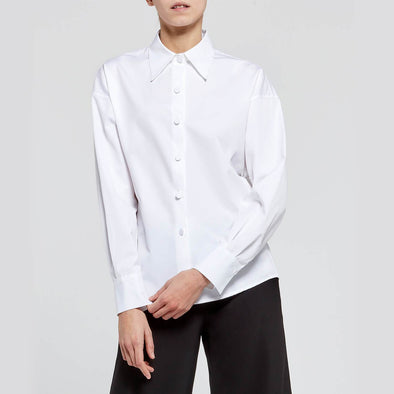 White round-shaped shirt with fabric buttons.