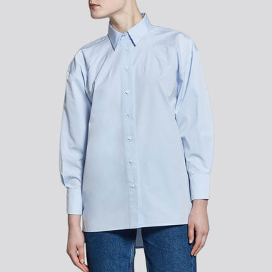 Light blue round-shaped shirt with high cuffs.
