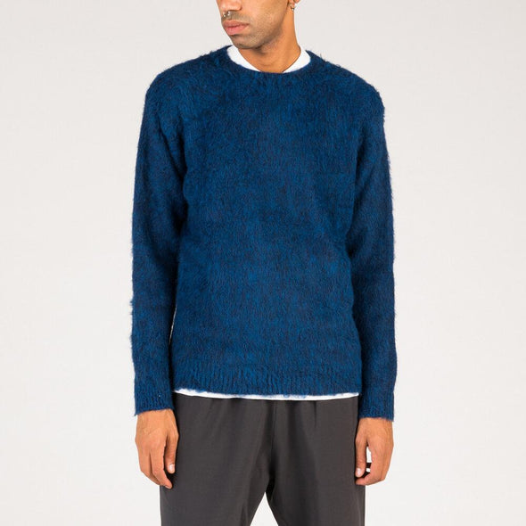 Loose fit handscrubbed knit in french blue.