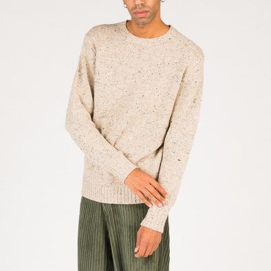 Speckled knit in soft beige.