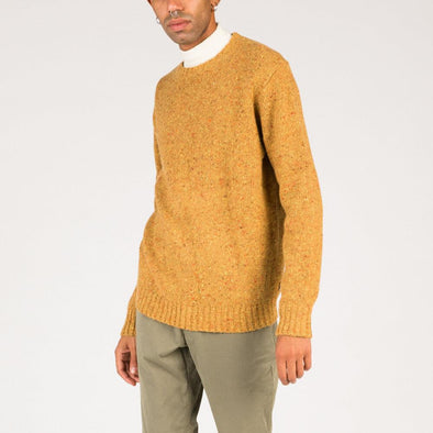 Speckled knit in ochre yellow.