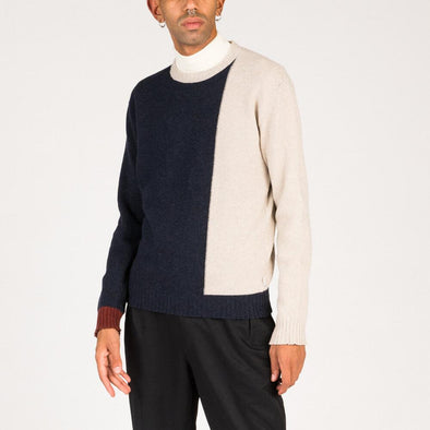 Vertical color blocked knit in navy blue and beige.