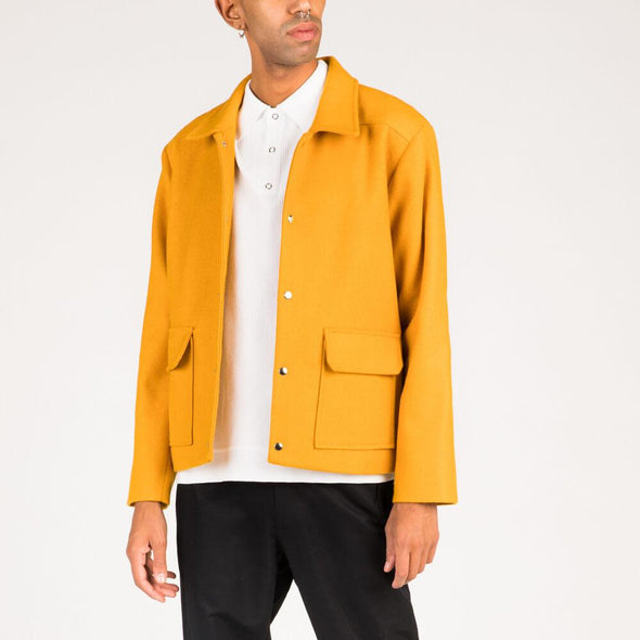Yellow wool coat.