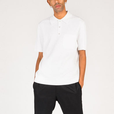 White knitted polo shirt.