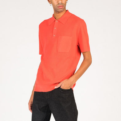 Coral knitted polo shirt.