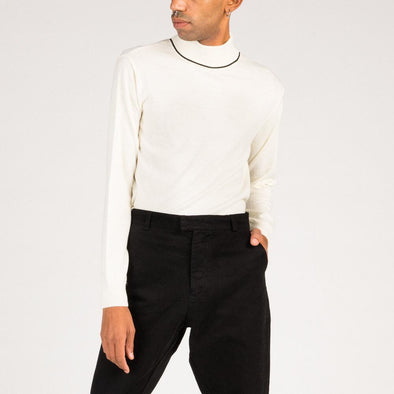 Ivory turtle neck with black detail.
