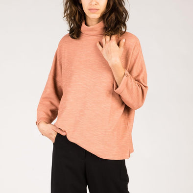 Rose roll-neck sweater with 3/4 length sleeves.