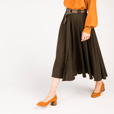 Brown wool panel skirt with removable knotted belt.