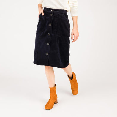 Navy blue corduroy skirt with patch pockets.