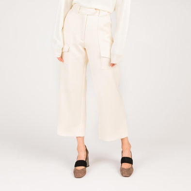 Cream a-line trousers in whipcord serge.