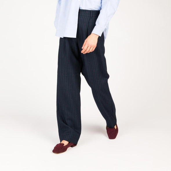 Navy blue high waisted flared trousers in tennis-weave slubbed twill.