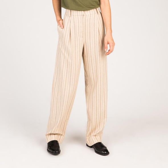Sand high waisted flared trousers in tennis-weave slubbed twill.