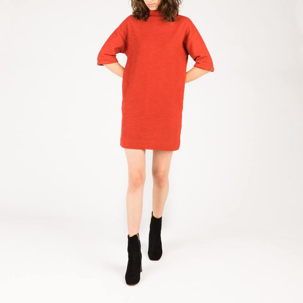 Red short dress with round neck and low armholes.