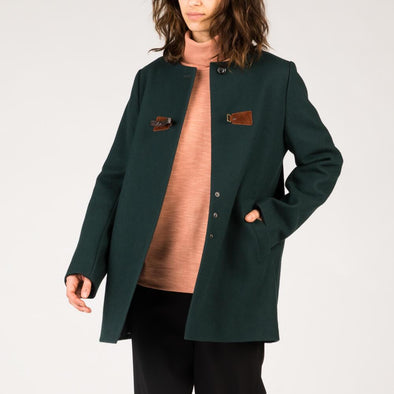 Deep green coat with leather buckle detail on the front.