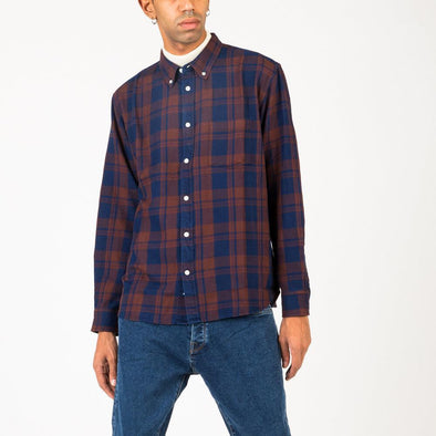 Yarn-dyed plaid shirt in clay and indigo.