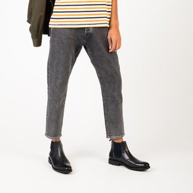 Relaxed fit cropped grey jeans with tapered legs.