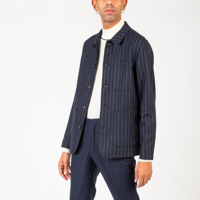 Navy blue striped blazer tailored from recycled polyester and wool.