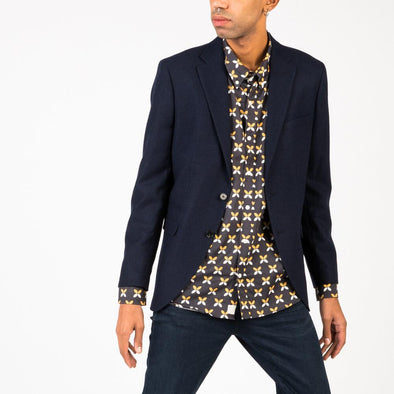 Classic fit navy blue blazer with a welt chest pocket and two flap pockets.