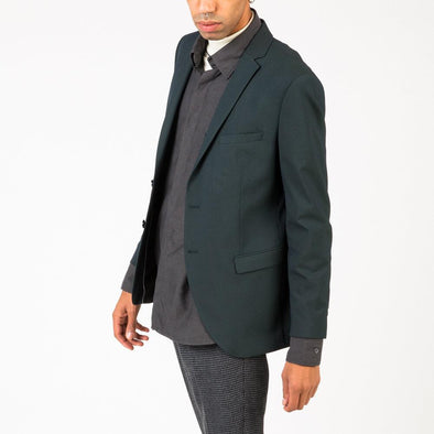 Classic fit green blazer with a welt chest pocket and two flap pockets.