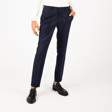 Navy blue classic suit trousers with press folds.
