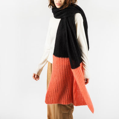 Long plaid scarf in black and salmon.