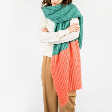 Long plaid scarf in turquoise and salmon.