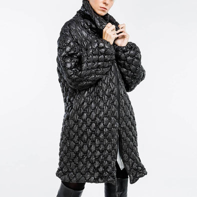 Black oversized padded jacket with high collar.