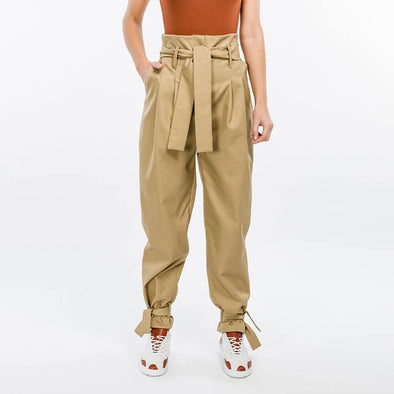 High waisted beige paper bag trousers.