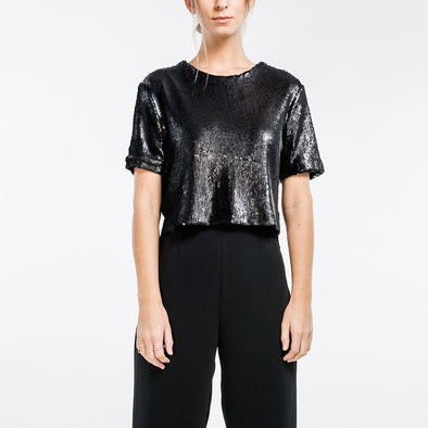Black asymmetrical sequined top with round neckline.