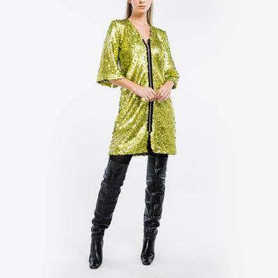 Lime green sequined dress with bell sleeves.