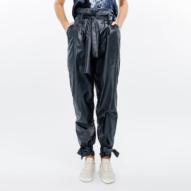 High waisted indigo paper bag trousers.