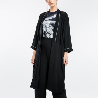 Long black kimono with contrasting neckline and cuffs.