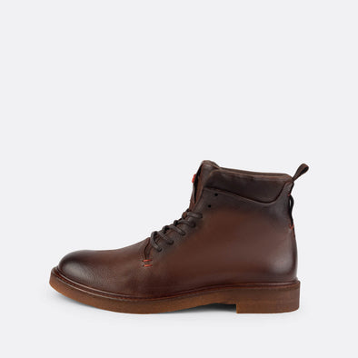 Brown leather lace-up boots with a sturdy crepe sole.