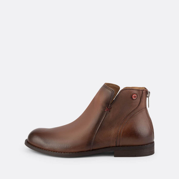 Brown leather boots with a back zip fastening.