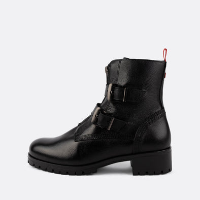 Black leather boots with buckle straps and a zipper.