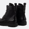 Black leather lace-up boots.