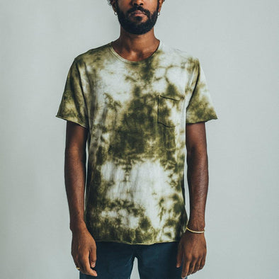 Loose fit tie dye green and white t-shirt with front pocket.