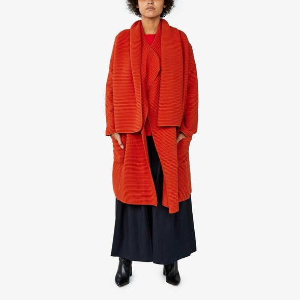 Asymmetric wrap long coat made from a wrinkled effect cotton knit.