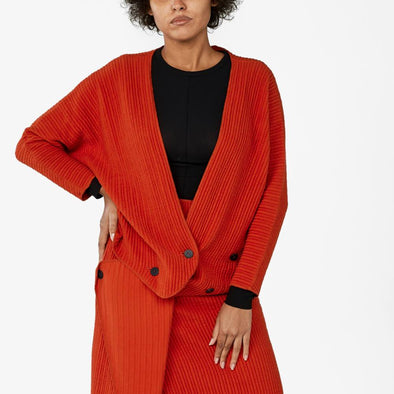 Wrap red bomber is made of a wrinkled effect cotton knit and features adjustable button fastening at the front.