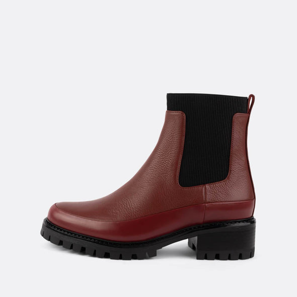 Slip on red leather ankle boots with ribbed elastic and robust sole.