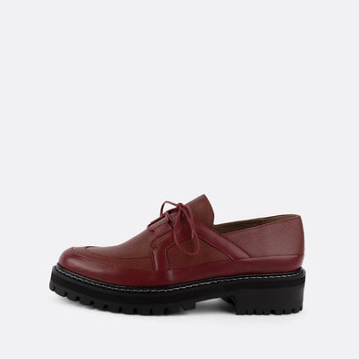 Lace-up red loafers with robust sole.