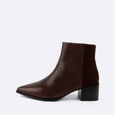 Brown leather and suede ankle boots with zipper and pointed toe.