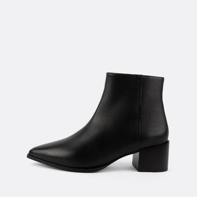 Black leather heeled ankle boots with zipper and pointed toe.