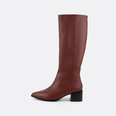 Knee-high red leather boots with side zipper and pointed toe.