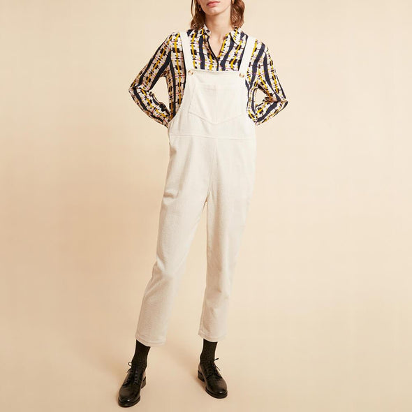 Regular fit white overalls with side pockets.