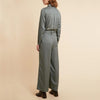 Wide cut shore green jumpsuit with side pockets.